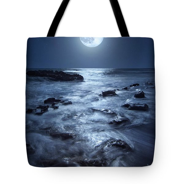 Tote Bag featuring the photograph Full Moon Rising Over Coral Cove Beach In Jupiter, Florida by Justin Kelefas