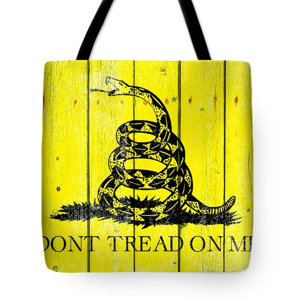 Gadsden Flag On Old Wood Planks Tote Bag by M L C