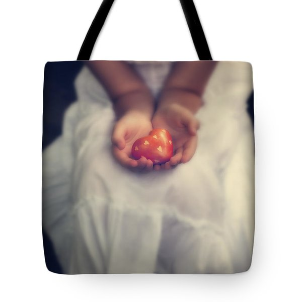 Girl Is Holding A Heart Tote Bag by Joana Kruse