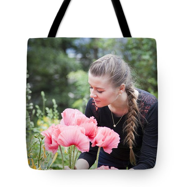 Girl With Red Flowers Tote Bag