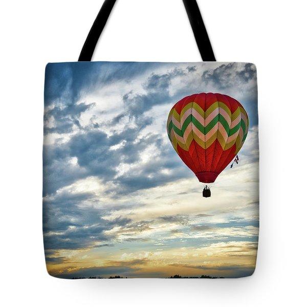 Gliding Through Sunset Tote Bag