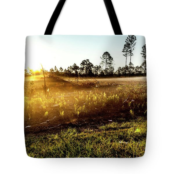 Tote Bag featuring the photograph Glow by Eric Christopher Jackson