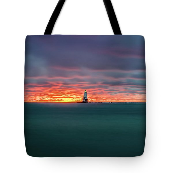 Glowing Sunset On Lake With Lighthouse Tote Bag