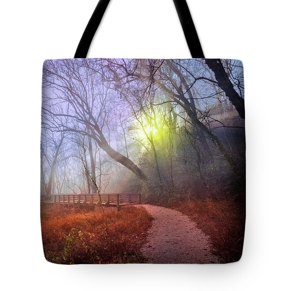 Tote Bag featuring the photograph Glowing Through The Trees by Debra and Dave Vanderlaan