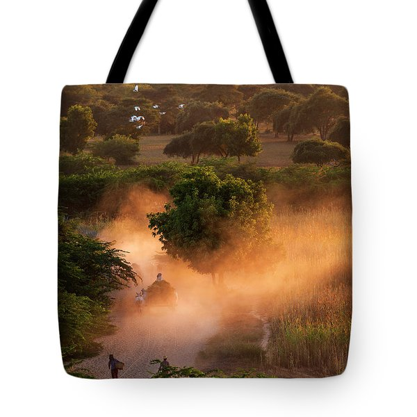Tote Bag featuring the photograph Going Home At Sunset by Pradeep Raja Prints