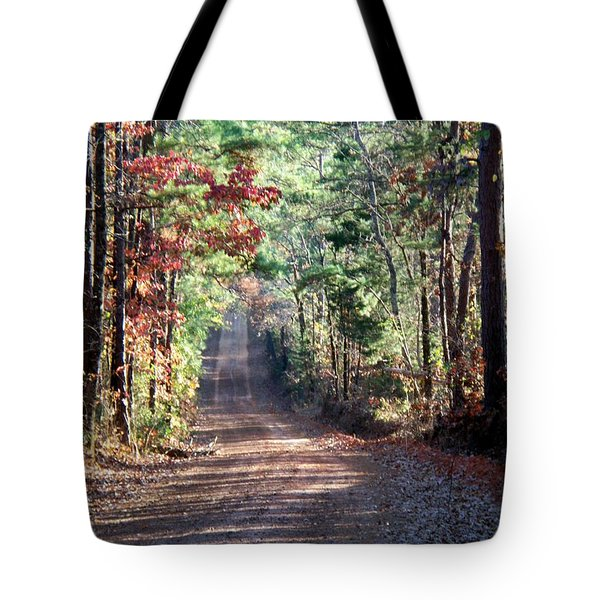 Tote Bag featuring the photograph Going Home by Betty Northcutt