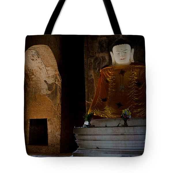 Gold Shrouded Buddha In Burma Basks In Natural Light By Temple Portal Tote Bag by Jason Rosette