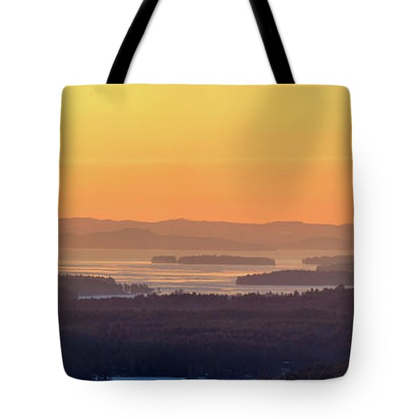 Golden Dawn Over Squam And Winnipesaukee Tote Bag by Sebastien Coursol