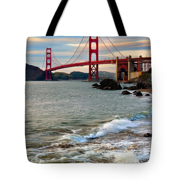 Golden Gate Bridge And The Pacific Ocean At Sunset With Waves Tote Bag by Wernher Krutein