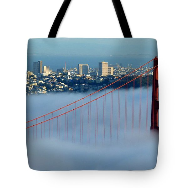 Golden Gate Bridge Tower In Sunshine And Fog Tote Bag by Jeff Lowe
