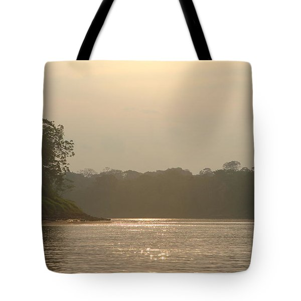 Golden Haze Covering The Amazon River Tote Bag