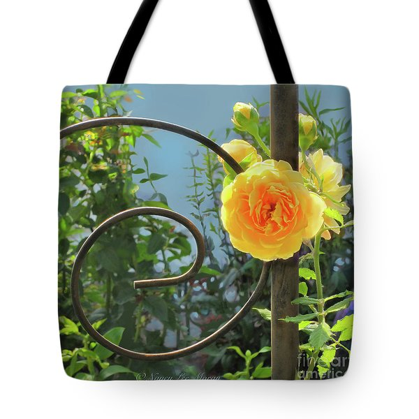 Tote Bag featuring the photograph Golden Ruffled Rose On Iron Trellis by Nancy Lee Moran