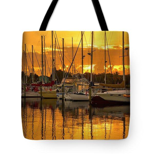 Golden Sailboat Sunrise Over Stuart Marina, Florida Tote Bag