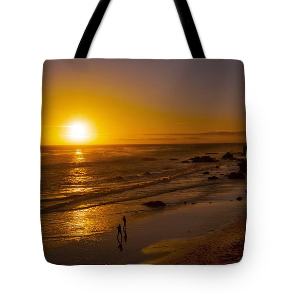 Tote Bag featuring the photograph Golden Sunset Walk On Malibu Beach by Jerry Cowart