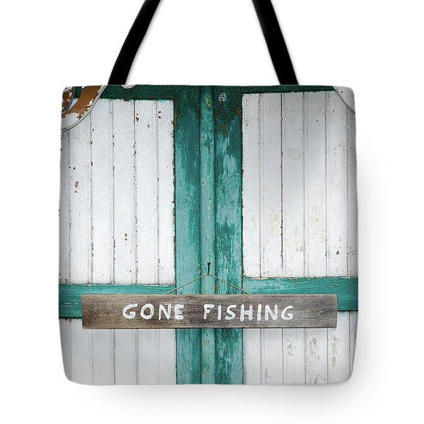 Tote Bag featuring the photograph Gone Fishing Sign At Weathered Doors by Kennerth and Birgitta Kullman