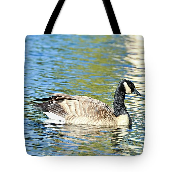 Tote Bag featuring the photograph Goose And Sun Reflections by David Lawson