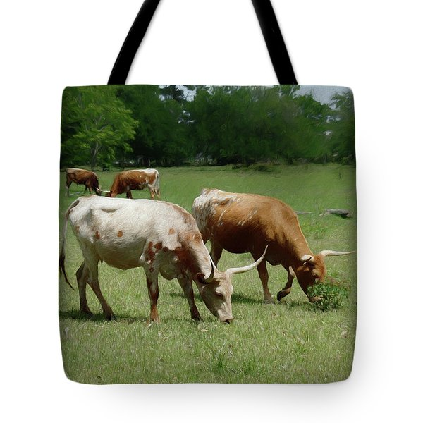 Tote Bag featuring the photograph Grazing Longhorns 1 by Travis Burgess