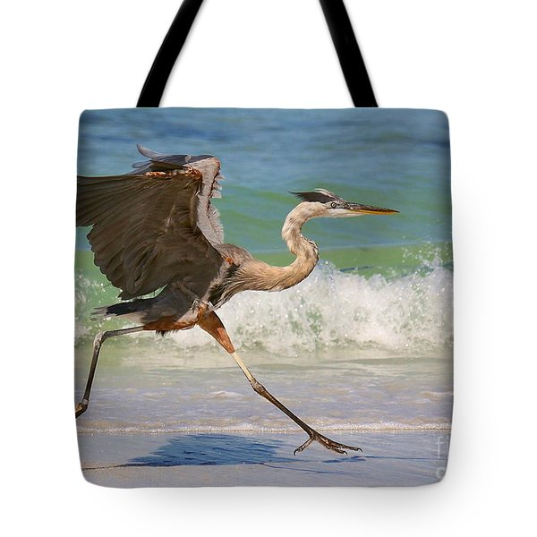 Great Blue Heron Running In The Surf Tote Bag