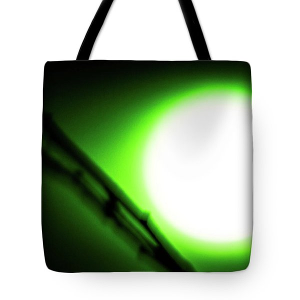 Tote Bag featuring the photograph Green Goblin by Tyson Kinnison