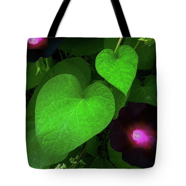 Tote Bag featuring the photograph Green Leaf Violet Glow by Roger Bester