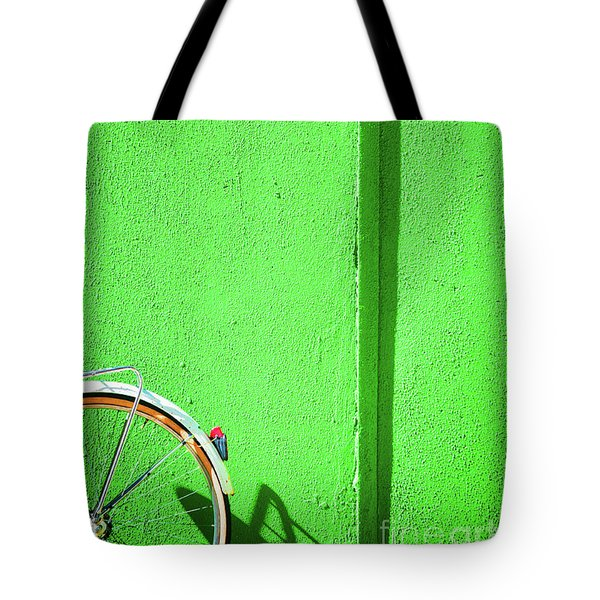 Tote Bag featuring the photograph Green Wall And Bicycle Wheel by Silvia Ganora