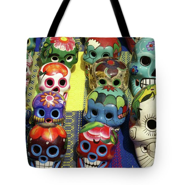 Tote Bag featuring the photograph Grinning Skulls by John  Mitchell