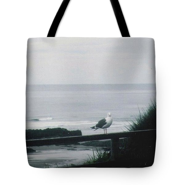 Tote Bag featuring the photograph Gull On A Rail by Charles Robinson