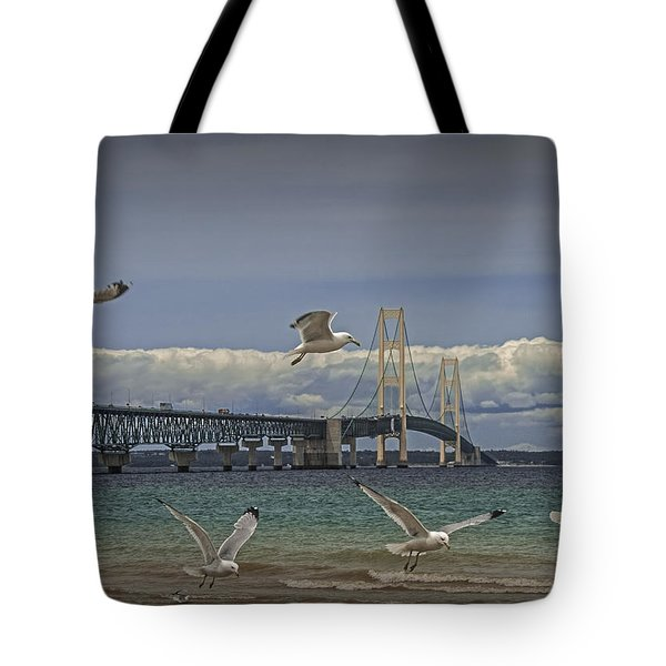 Gulls Flying By The Bridge At The Straits Of Mackinac Tote Bag by Randall Nyhof