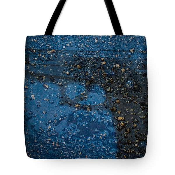 Tote Bag featuring the photograph Gun In Stone by Randy Sylvia