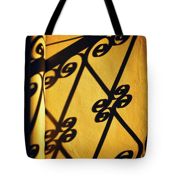 Tote Bag featuring the photograph Gutter And Ornate Shadows by Silvia Ganora