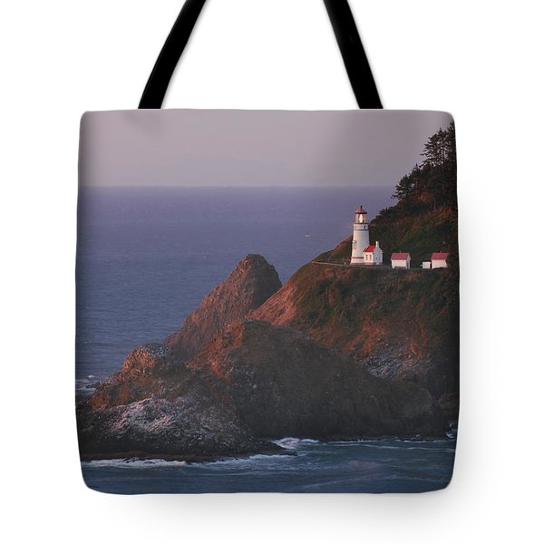 Haceta Head Lighthouse At Sunset Tote Bag