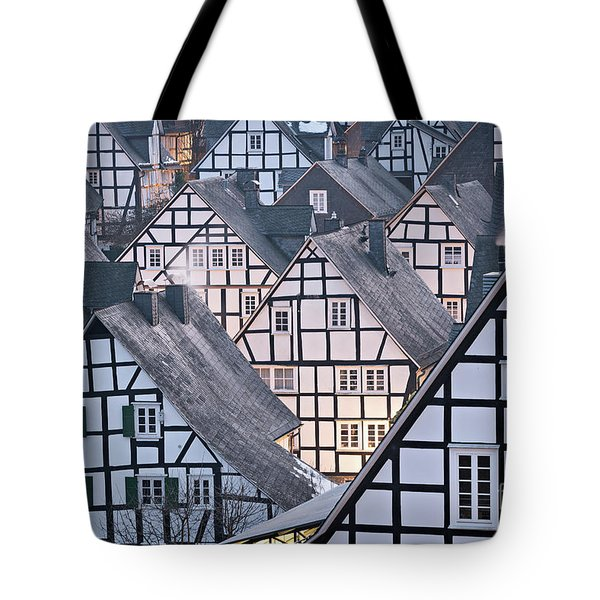 Tote Bag featuring the photograph Half-timbered Houses In Detail In Germany by IPics Photography