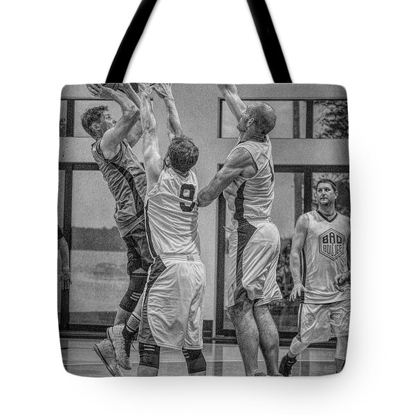 Tote Bag featuring the photograph Hamlin Elevating Over Defenders by Ronald Santini