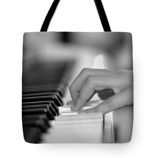 Hand On Piano Keyboard Tote Bag