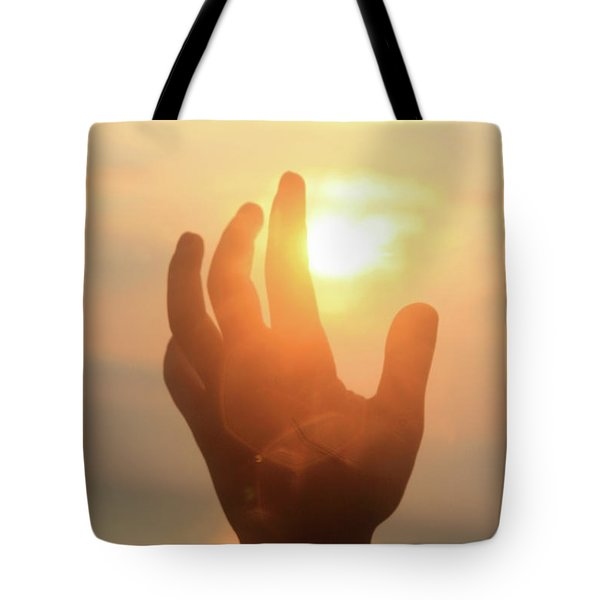 Hand Reaching Fore The Sun Tote Bag