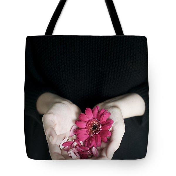 Hands Holding Pink Gerbera Daisies Tote Bag