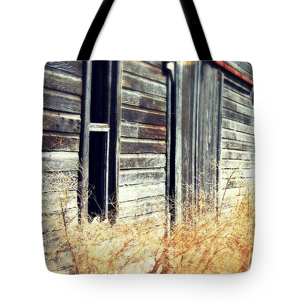 Tote Bag featuring the photograph Hanging By A Bolt by Julie Hamilton
