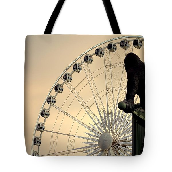 Tote Bag featuring the photograph Hanging On The Wheel by Valentino Visentini