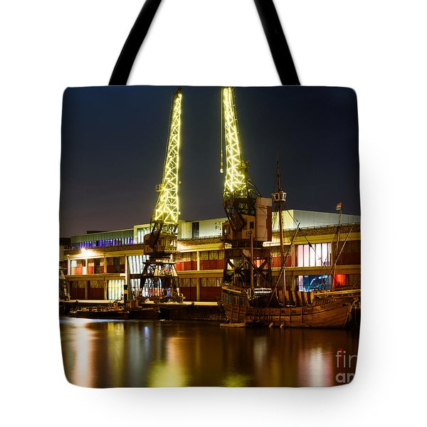 Tote Bag featuring the photograph Harbour Cranes by Colin Rayner