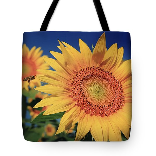 Tote Bag featuring the photograph Heading For Gold by Chris Berry