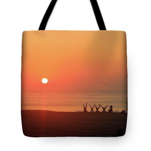 Tote Bag featuring the photograph Headstand Fun At Sunrise by Robert Banach