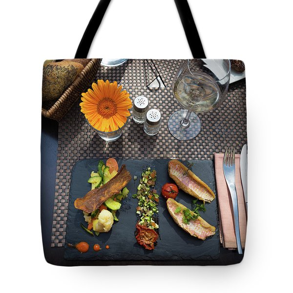 Tote Bag featuring the photograph Health Fish Dish Served At A French Restaurant by Semmick Photo