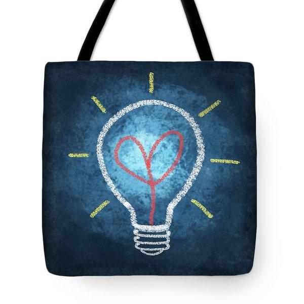 Heart In Light Bulb Tote Bag by Setsiri Silapasuwanchai