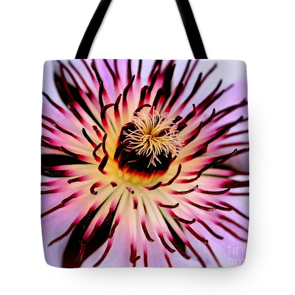 Tote Bag featuring the photograph Heart Of A Clematis by Baggieoldboy