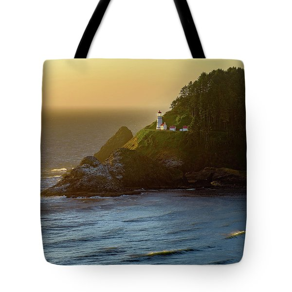Tote Bag featuring the photograph Heceta Head Lighthouse At Sunset by John Hight
