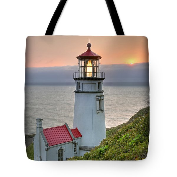 Heceta Lighthouse At Sunset Tote Bag by Martin Konopacki