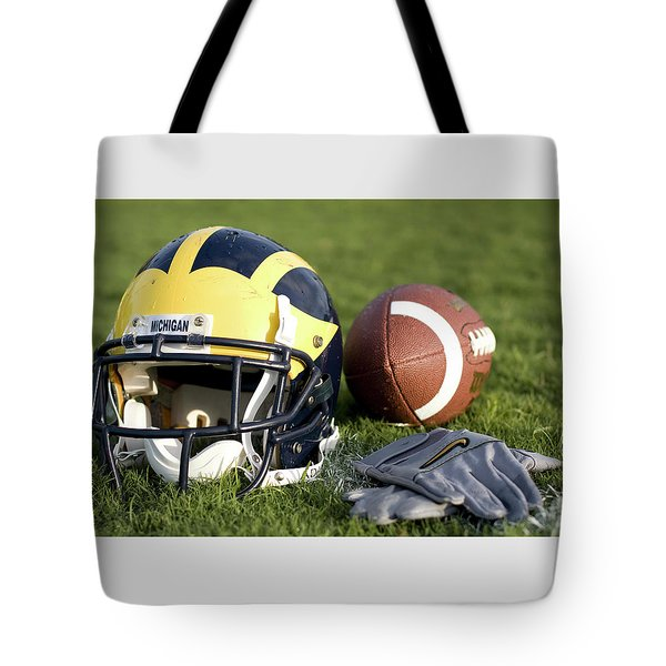 Helmet On The Field With Football And Gloves Tote Bag