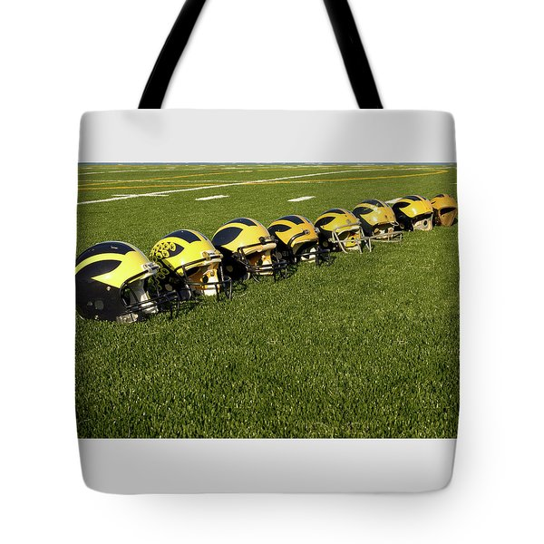 Helmets Of Different Eras On The Field Tote Bag