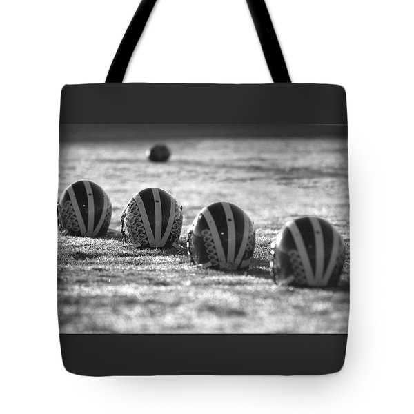 Helmets On Dew-covered Field At Dawn Black And White Tote Bag