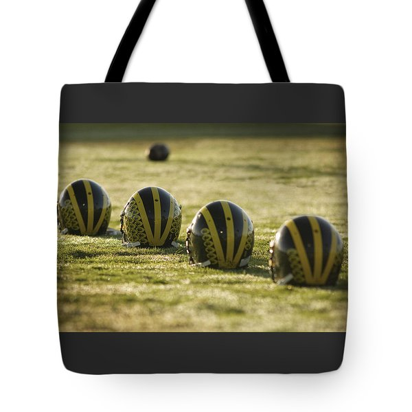 Helmets On Dew-covered Field At Dawn Tote Bag